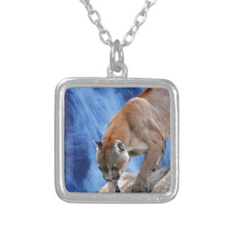 A mountain lion at the waterfall custom jewelry