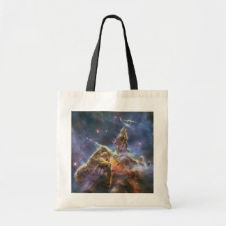 A mountain of dust and gas in the Carina Nebula Tote Bag