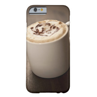 A mug of Cappuccino coffee topped with melted Barely There iPhone 6 Case