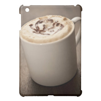 A mug of Cappuccino coffee topped with melted Case For The iPad Mini