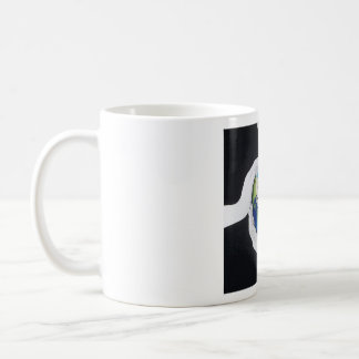 A mug with the world in your hands