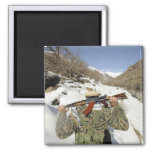A Mujahadeen Guard walks with US Military membe 2 Inch Square Magnet