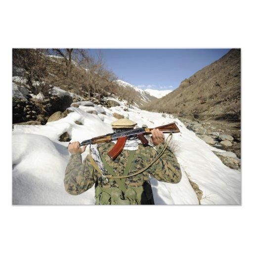 A Mujahadeen Guard walks with US Military membe Photo Print