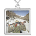 A Mujahadeen Guard walks with US Military membe Square Pendant Necklace