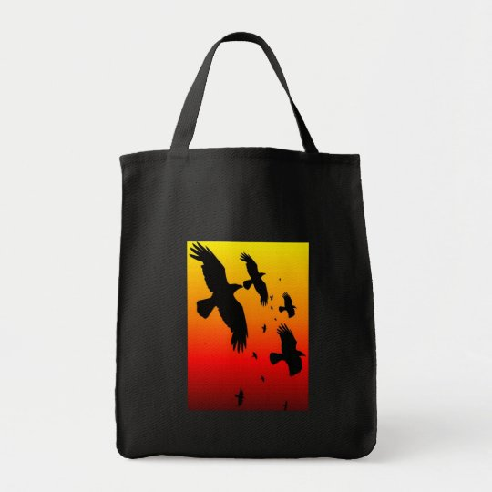 A Murder of Crows Against A Haunting Sunset Tote Bag