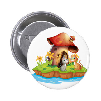 A mushroom house with two cats 2 inch round button