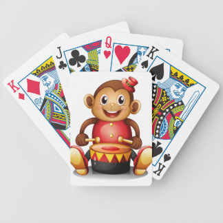 A musical monkey toy bicycle playing cards