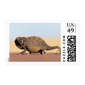 A Namaqua Chameleon walking across a sandy plain Postage Stamp
