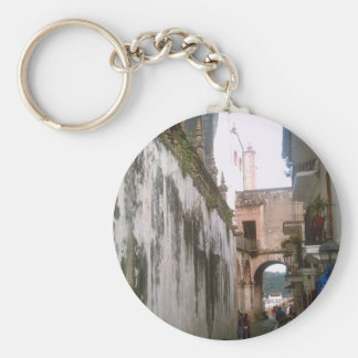 A narrow street below Taxco Cathedral Basic Round Button Keychain