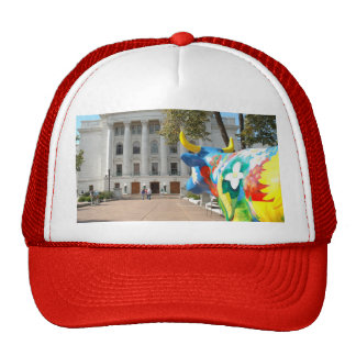 A Painted Cow Admires the Capital Building Trucker Hat