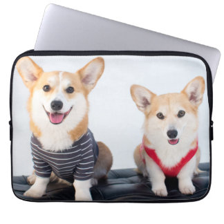 A Pair Of Corgis Sitting On A Bench Laptop Sleeve