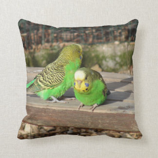A Pair of Green Budgies on a wooden bench Pillows