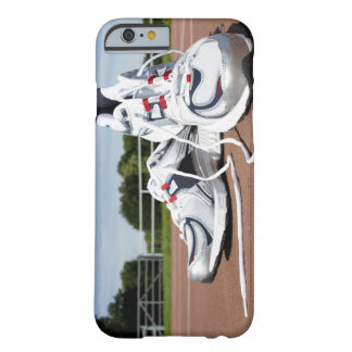 A pair of new white running trainers are placed barely there iPhone 6 case