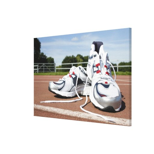A pair of new white running trainers are placed stretched canvas prints