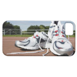 A pair of new white running trainers are placed iPhone 5 case
