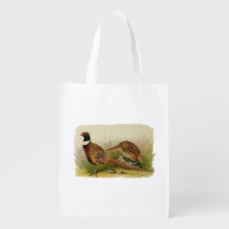 A pair of Ring necked pheasants in a grassy field Grocery Bag