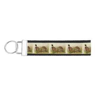 A pair of Ring necked pheasants in a grassy field Wrist Keychain