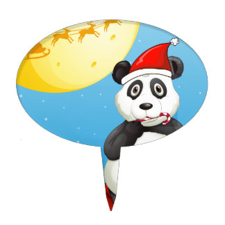 A panda wearing Santa's hat while eating a cane lo Cake Topper