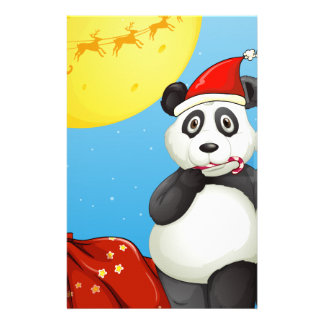 A panda wearing Santa's hat while eating a cane lo Stationery