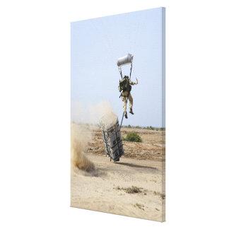 A pararescueman drops into the zone canvas print