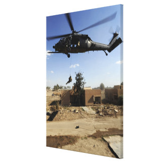 A pararescueman rappels from an HH-60 2 Canvas Print