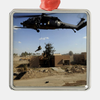 A pararescueman rappels from an HH-60 2 Metal Ornament