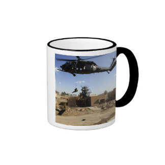 A pararescueman rappels from an HH-60 2 Ringer Mug