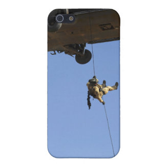 A pararescueman rappels from an HH-60 iPhone 5 Covers