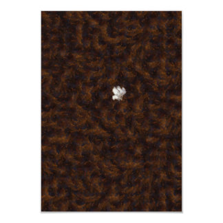 A patch of white surrounded by brown 3.5x5 paper invitation card