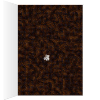 A patch of white surrounded by brown greeting card