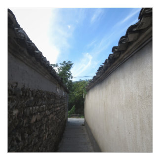 A path between two walls towards the sky photograph