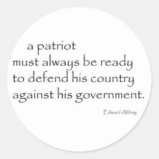 """A Patriot must..."" Classic Round Sticker"