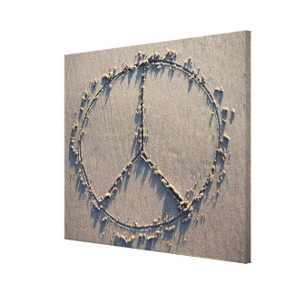 A peace sign drawn in the sand. canvas print