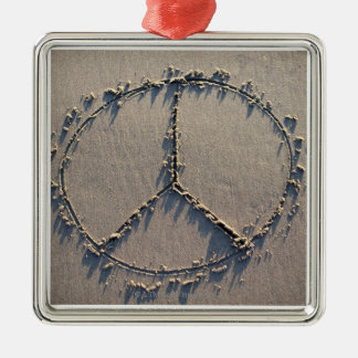 A peace sign drawn in the sand. metal ornament