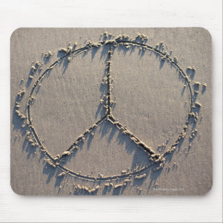 A peace sign drawn in the sand. mouse pad
