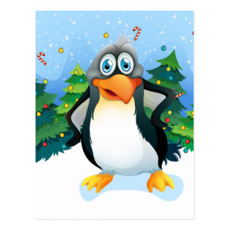 A penguin near the christmas trees postcard