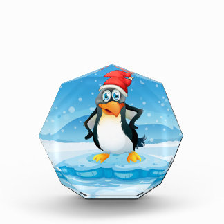 A penguin wearing Santa's hat standing above an ic Acrylic Award