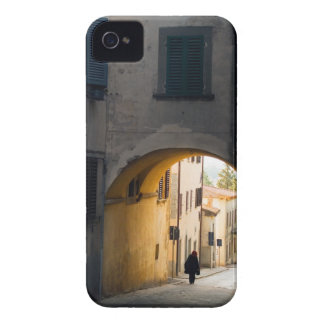 A person walking under an arch, down a hill in blackberry bold case
