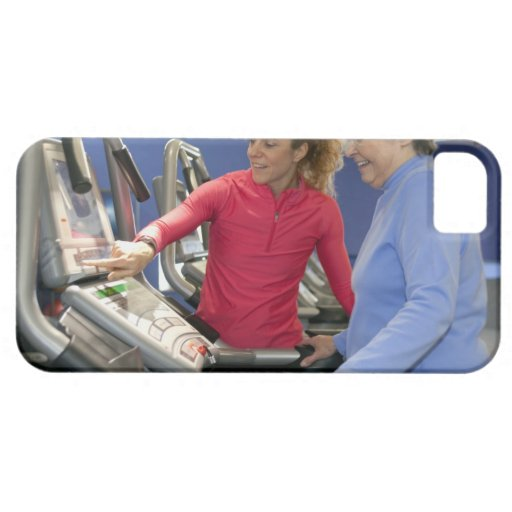A personal trainer helps a senior woman on a iPhone SE/5/5s case