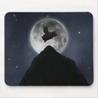 A pig flies across full moon over mountain peak mouse pad