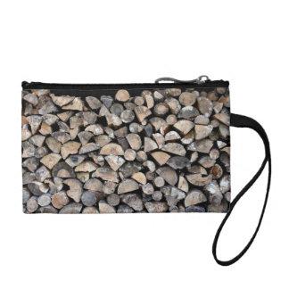 A pile of cut wooden logs change purse