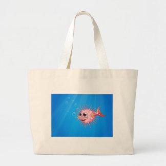 A pink puffer fish in the ocean jumbo tote bag