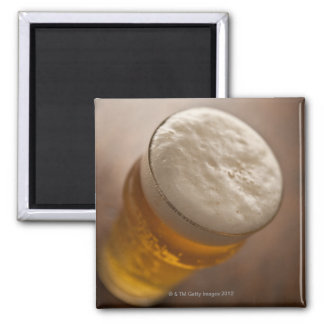 A pint of lager, back lir shallow focus rustic 2 inch square magnet