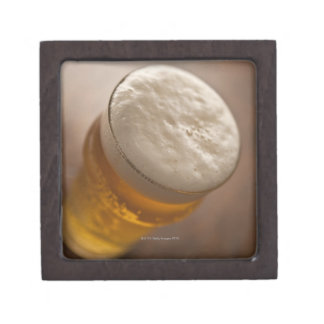 A pint of lager, back lir shallow focus rustic keepsake box