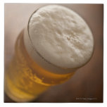 A pint of lager, back lir shallow focus rustic large square tile