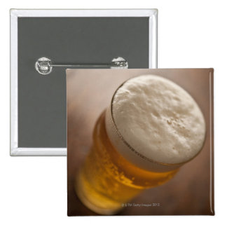 A pint of lager, back lir shallow focus rustic pinback button