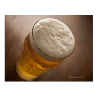 A pint of lager, back lir shallow focus rustic postcard