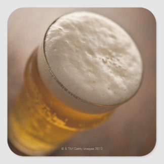 A pint of lager, back lir shallow focus rustic square sticker