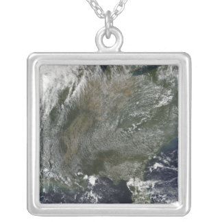 A pinwheel-like pattern of high pressure clouds silver plated necklace