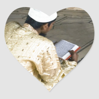 A pious devotee reading the Quran Sticker